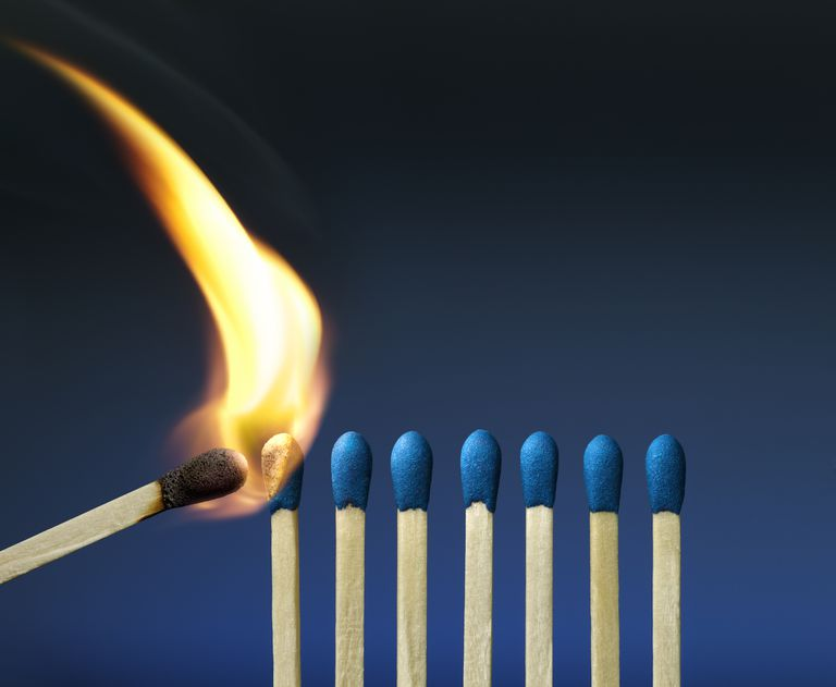 The heat of a lit match can provide the activation energy needed for combustion.