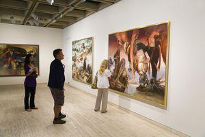 Admiring art in a gallery