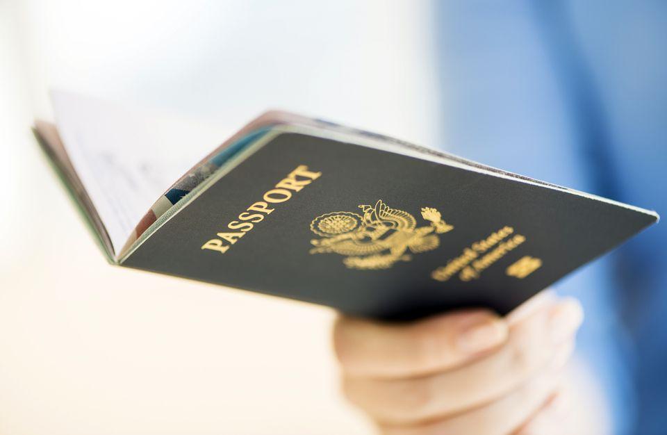 Person holding an open US passport