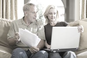 Couple sitting on couch making a retirement income plan.