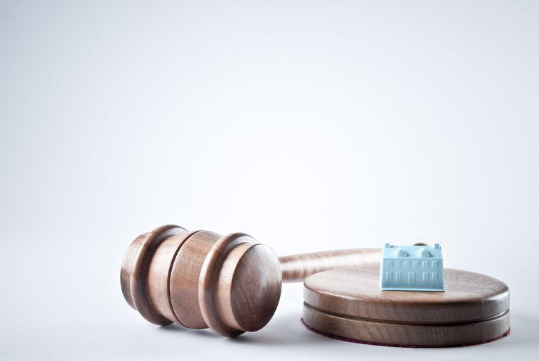 home figurine on judge's gavel