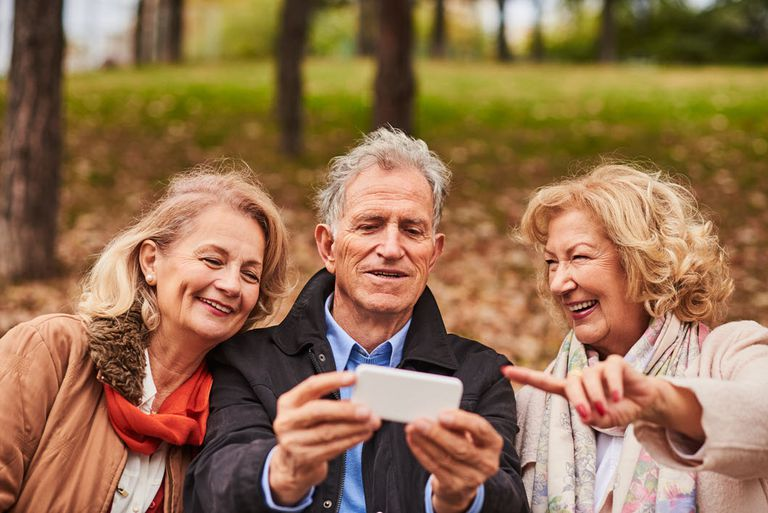 Senior adults with smartphone.