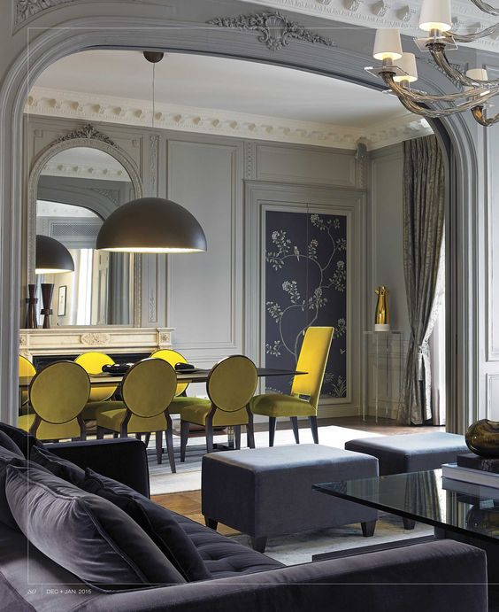 Bright Yellow Chairs Creating Contrast In A Gray Dining Room