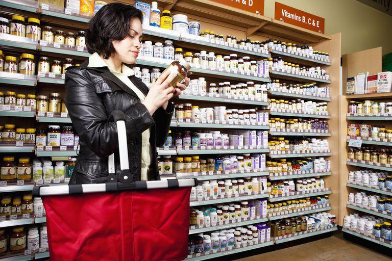 USA, California, San Rafael, Woman shopping in drug store