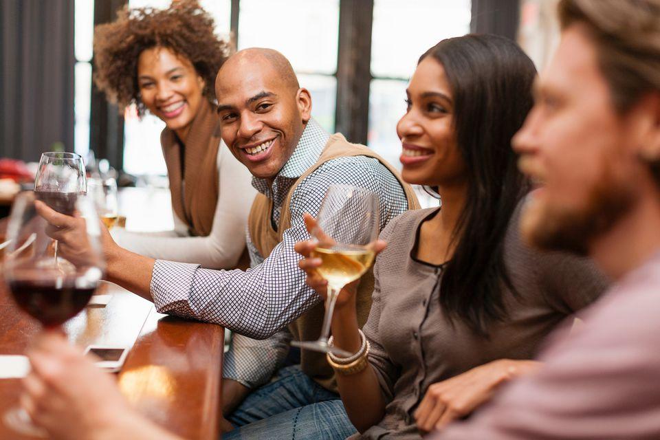 Four friends having fun at wine bar