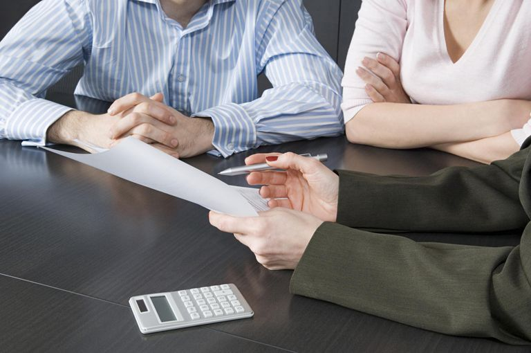 Bank manager helping couple