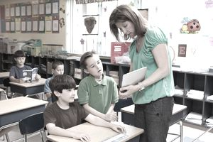 Teacher using ipad / tablet to teach kids