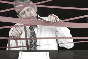 Man fighting through red tape