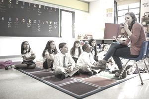 Teacher Reading a Picture Book to Students