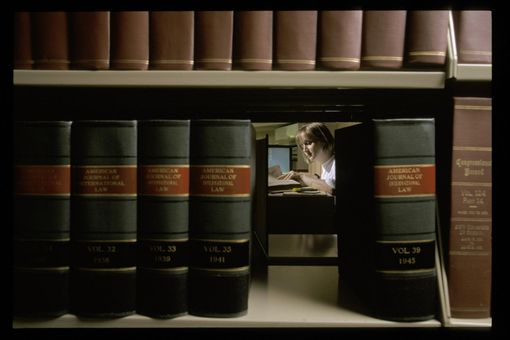 Law student studying at law library.