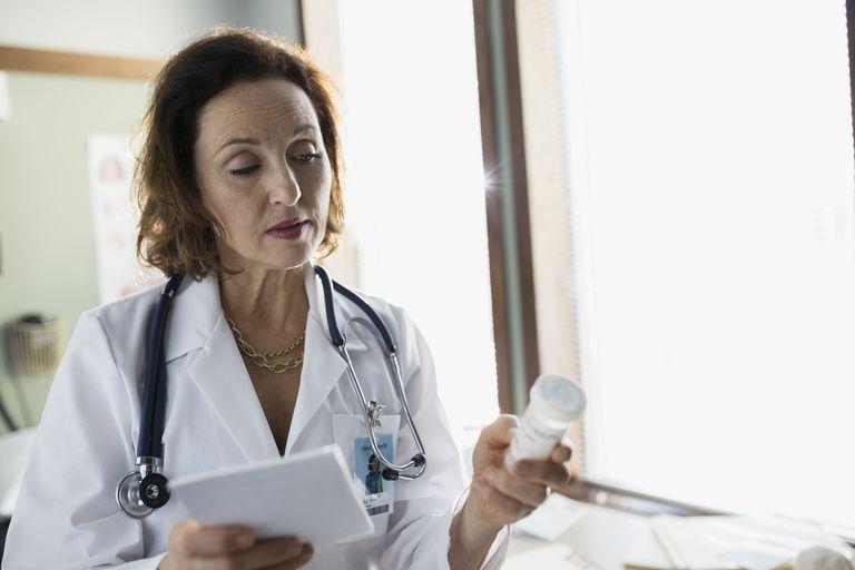 Doctor checking prescription bottle