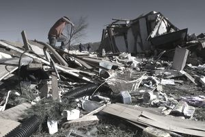 Tornado Victim Looking at Rubble