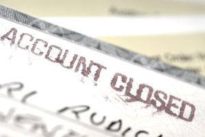 """Check with """"account closed"""" written on it, close-up"""