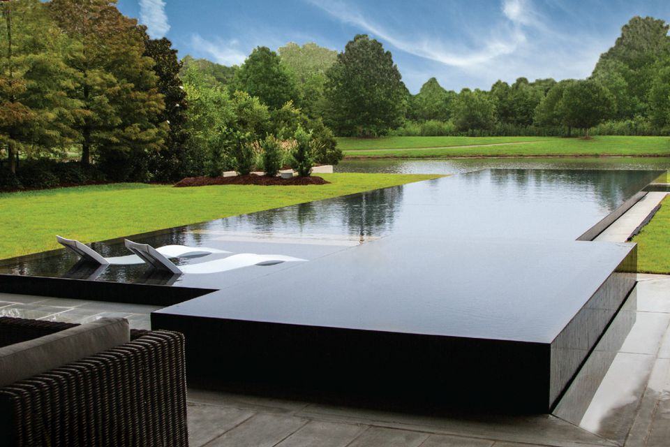 rectangular infinity pool in modern backyard apsp