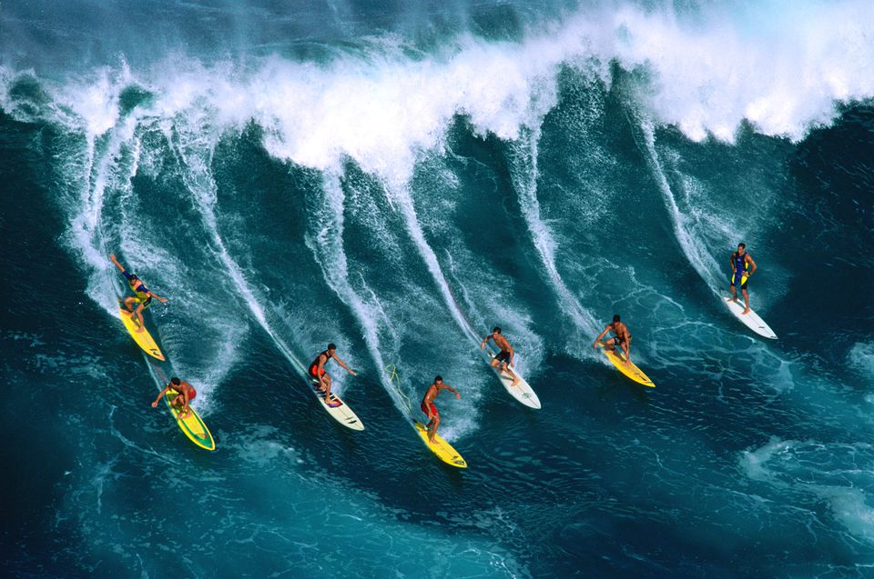 Surfers riding waves in Hawaii