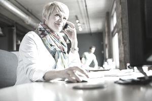 Female entrepreneur using mobile phone at desk