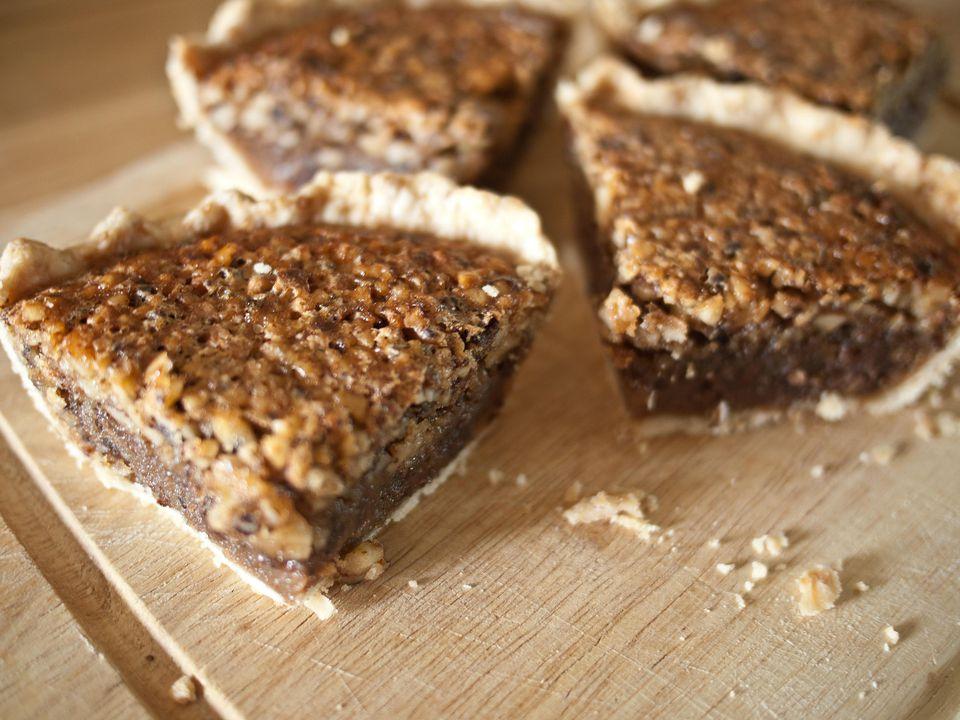 Kentucky bourbon chocolate walnut pie slices on a cutting board