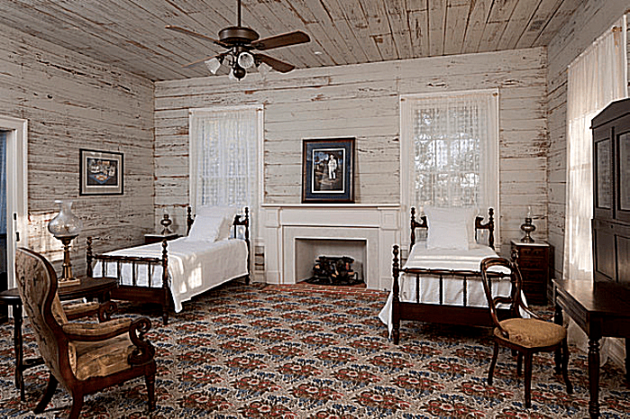 bastrop county 1850s plantation house southwest bedroom by rick patrick photography - Country House Style