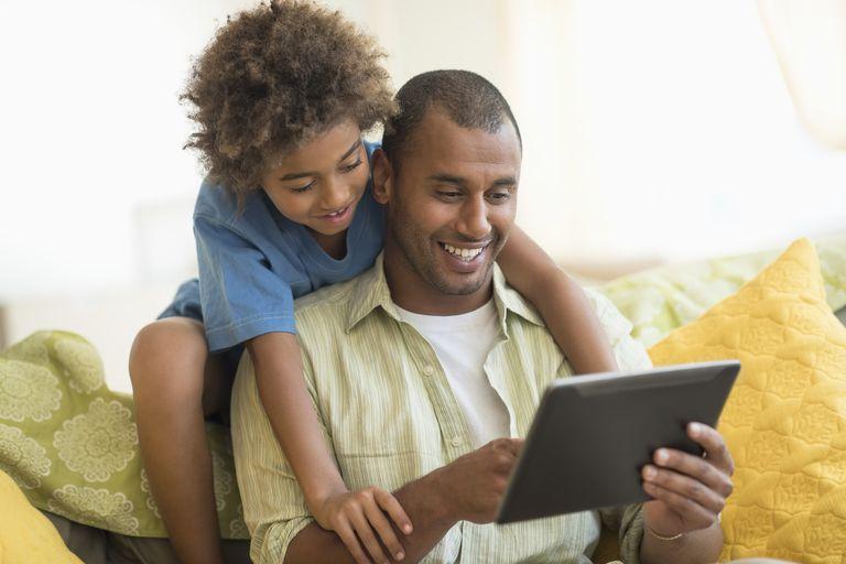 Man and son looking at computer
