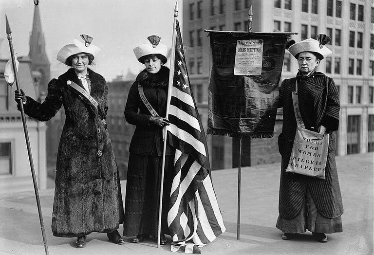 Suffrage protesters with flag