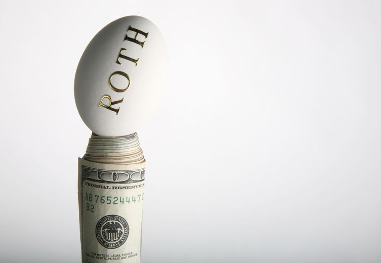 Roth written on egg, sitting on stack of dollars.