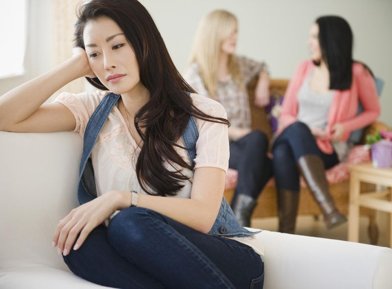 Sad woman isolated from friends
