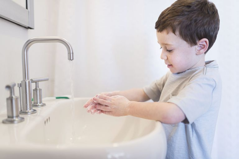 USA, New Jersey, Jersey City, Boy (6-7) washing hands