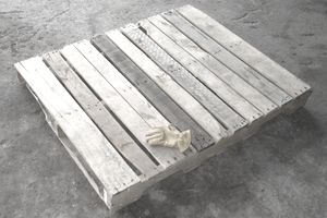 Picture of a wooden pallet with a glove