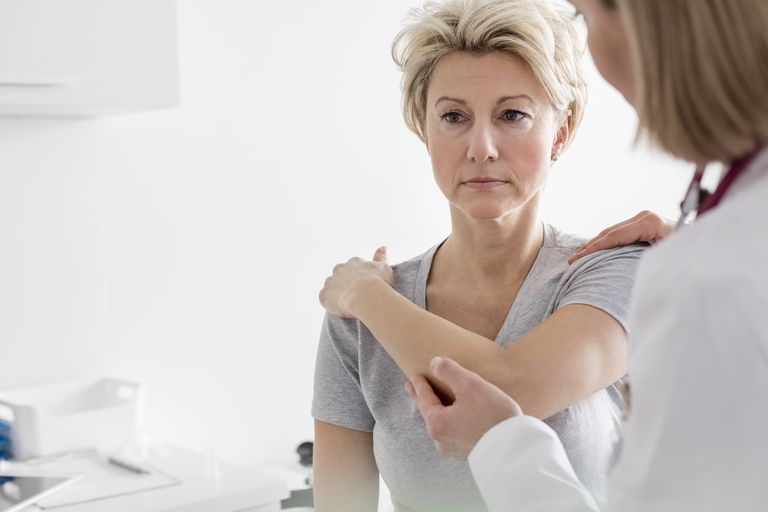 Doctor examining patients shoulder