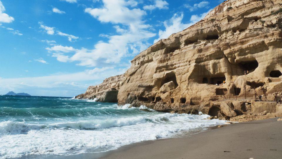Caves overlooking beach in Greece, Crete.