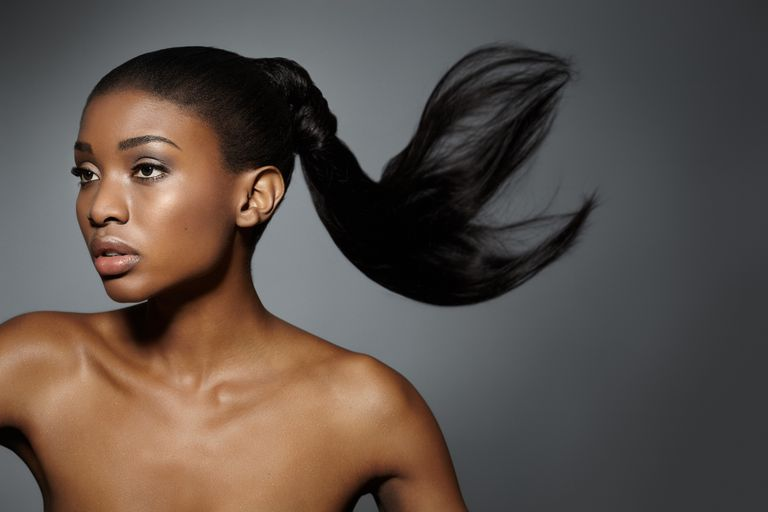 Woman with long, relaxed hair.