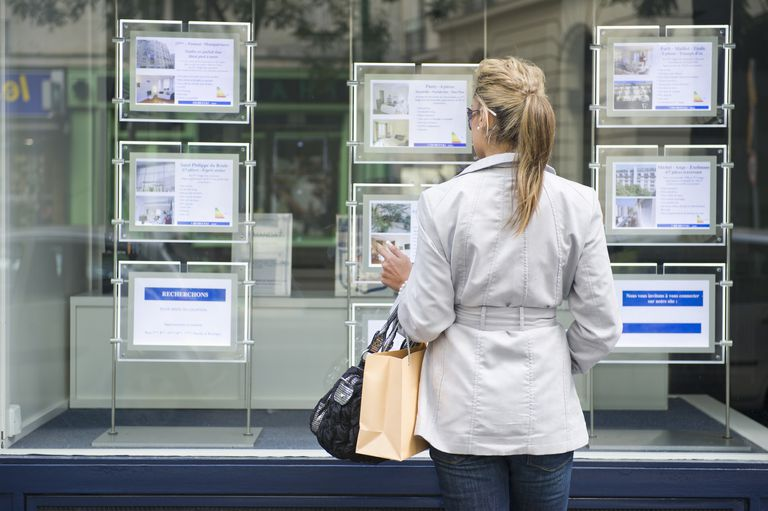 woman looking at real estate ads