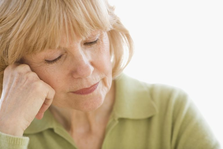 Mature woman resting her head on her hand