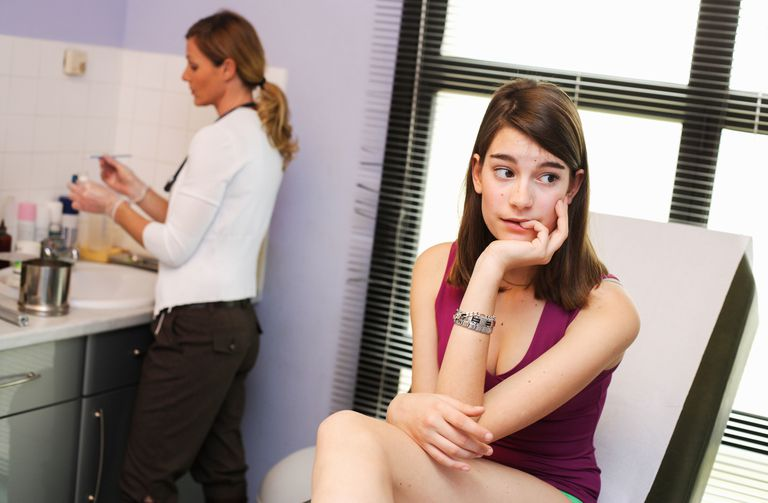 Anxious women having medical test considers internet safety