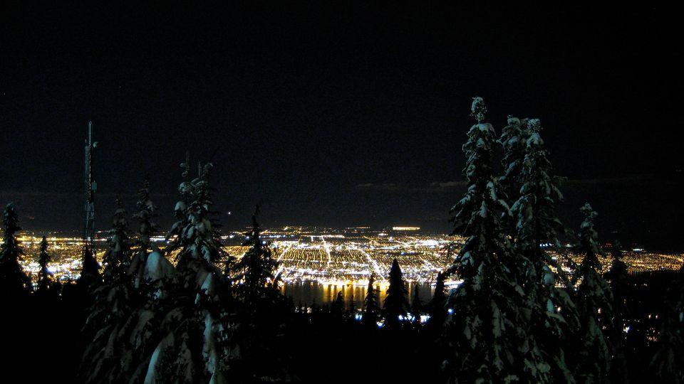 Illuminated Cityscape At Night Viewed From Mountain