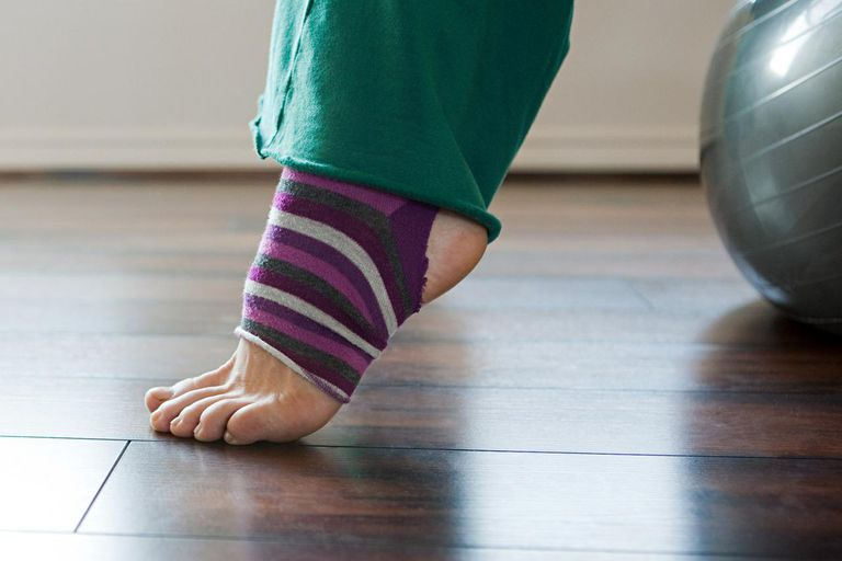 Women wearing stripey legwarmers on exercise ball