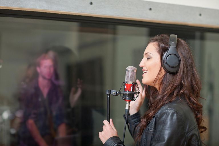 Woman recording music at studio