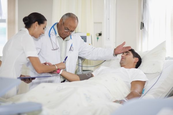 Doctor and nurse with hospital patient