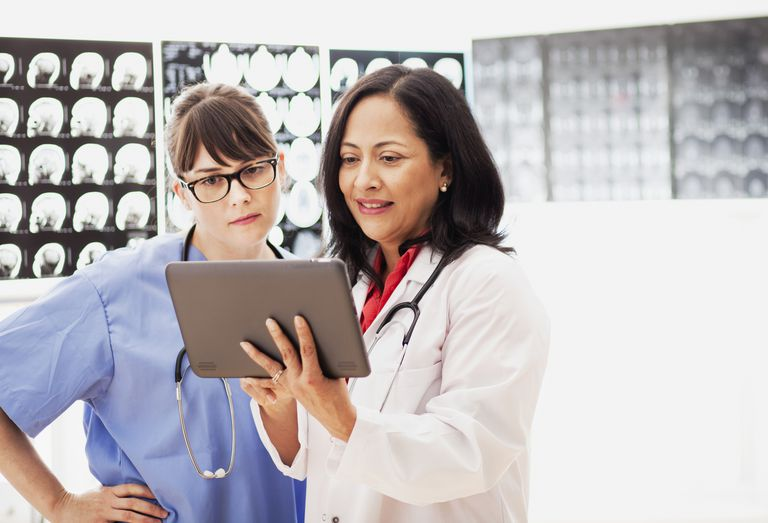 Health care professionals using tablet