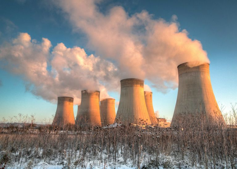 Power plant cooling towers at sunrise