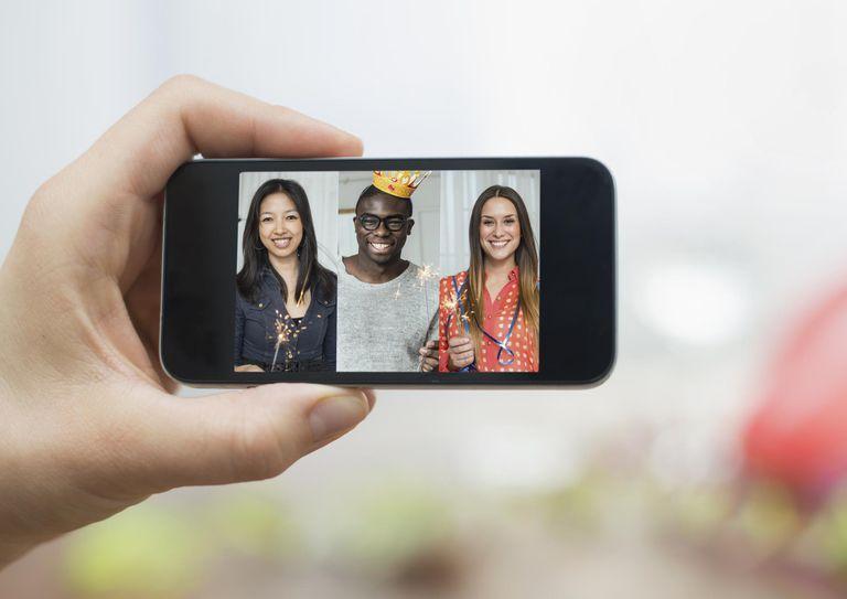 Three partypeople displayed on smartphonetphone