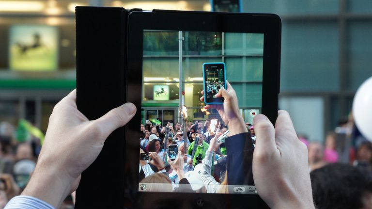 An iPad taking a photo of an iPhone taking a photo.