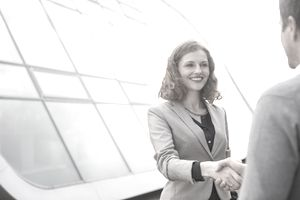 Business people shaking hands outdoors