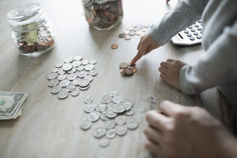 Insurance premium explained photo of collecting money in piles