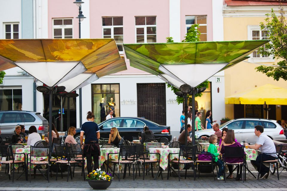 People at a outdoor cafe, Town Hall Square, Old Town, Vilnius, Lithuania