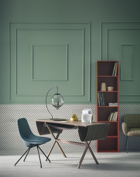 Dining room with architectural elements highlighted by green wall paint