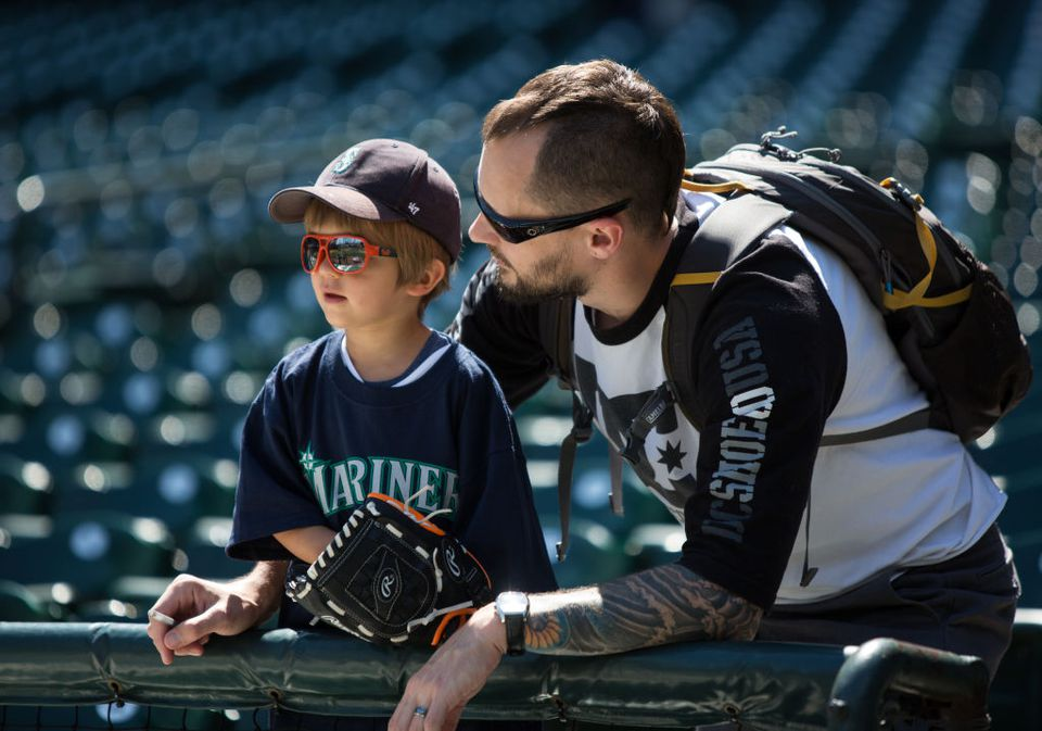 A young Seattle Mariners fan watches batting practice before the game against the Oakland Athletics at Safeco Field on July 9, 2017 in Seattle, Washington. The Seattle Mariners beat the Oakland Athletics 4-0