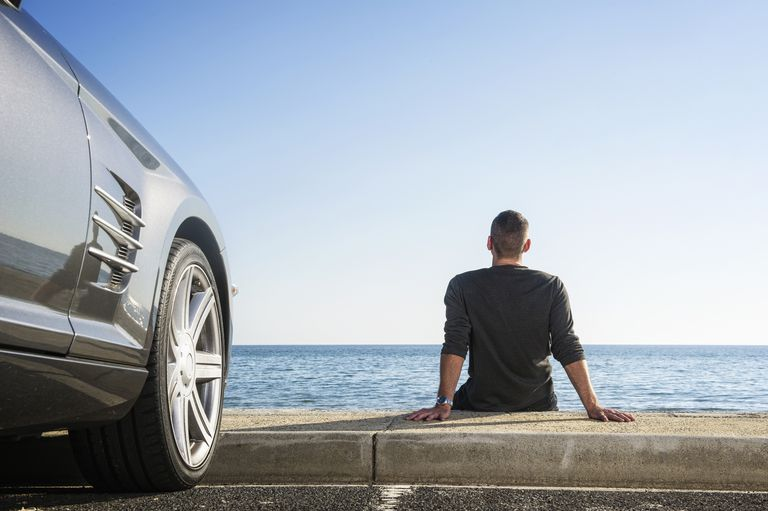 Man sitting near new car wondering where to purchase gap insurance