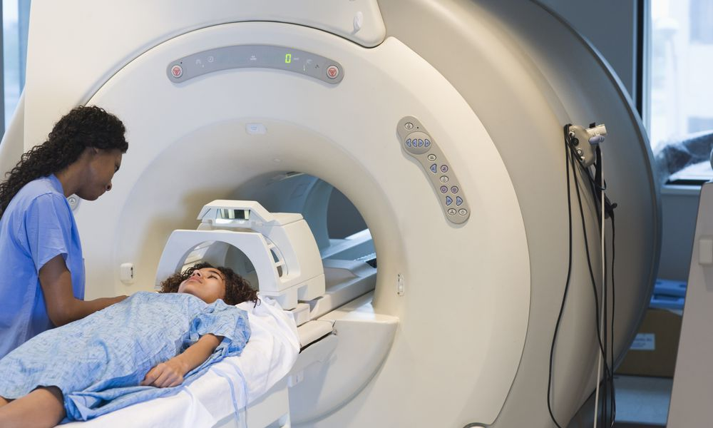 Doctor preparing patient for MRI