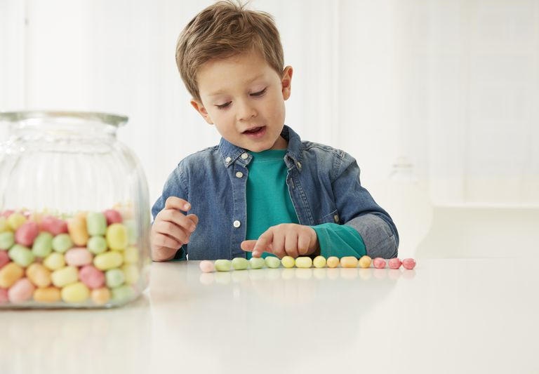 Boy with candy jar, counting candies